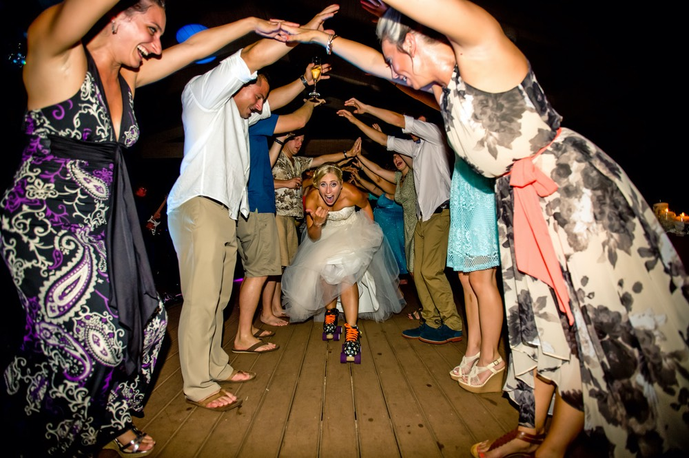 Bride wearing roller-skates at kauai wedding