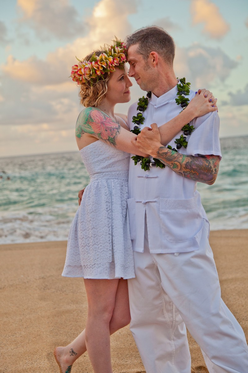 The bride with the stunning shoulder tattoo. filmed by Difraser Kauai -  Kauai wedding photography packages,
