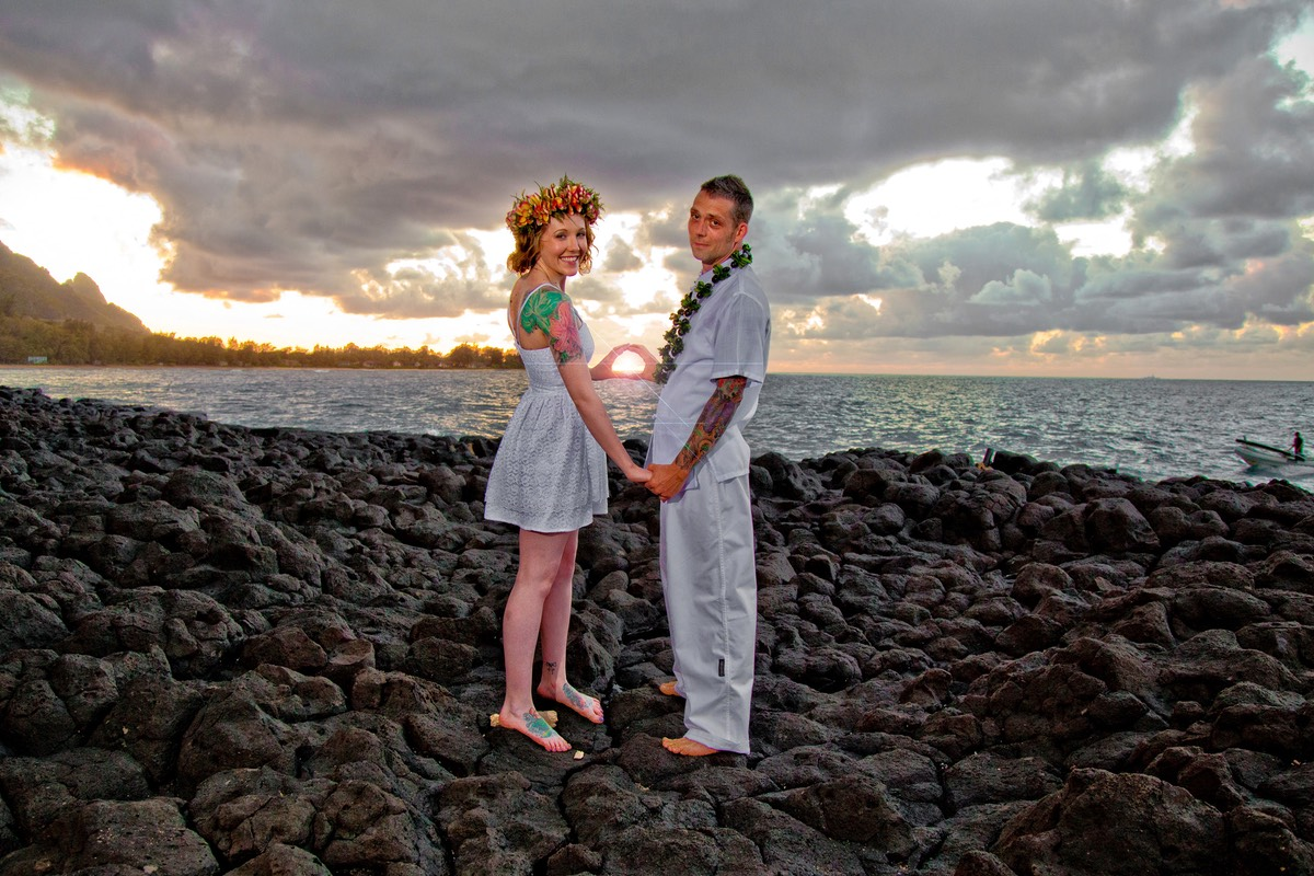 Kauai sunset in the palm of a hand or two hands. Wedding photography.