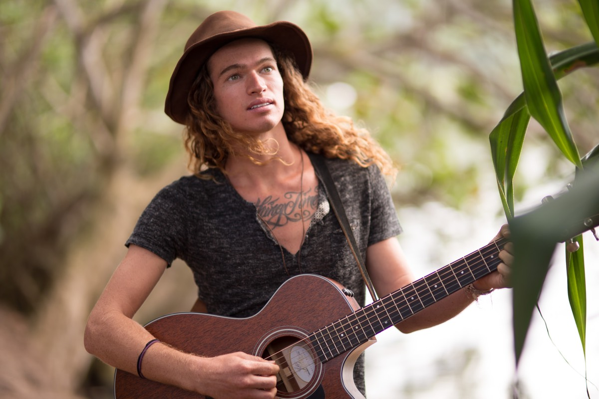 Kauai male model Steven Sedalia looks up for inspiration for new song