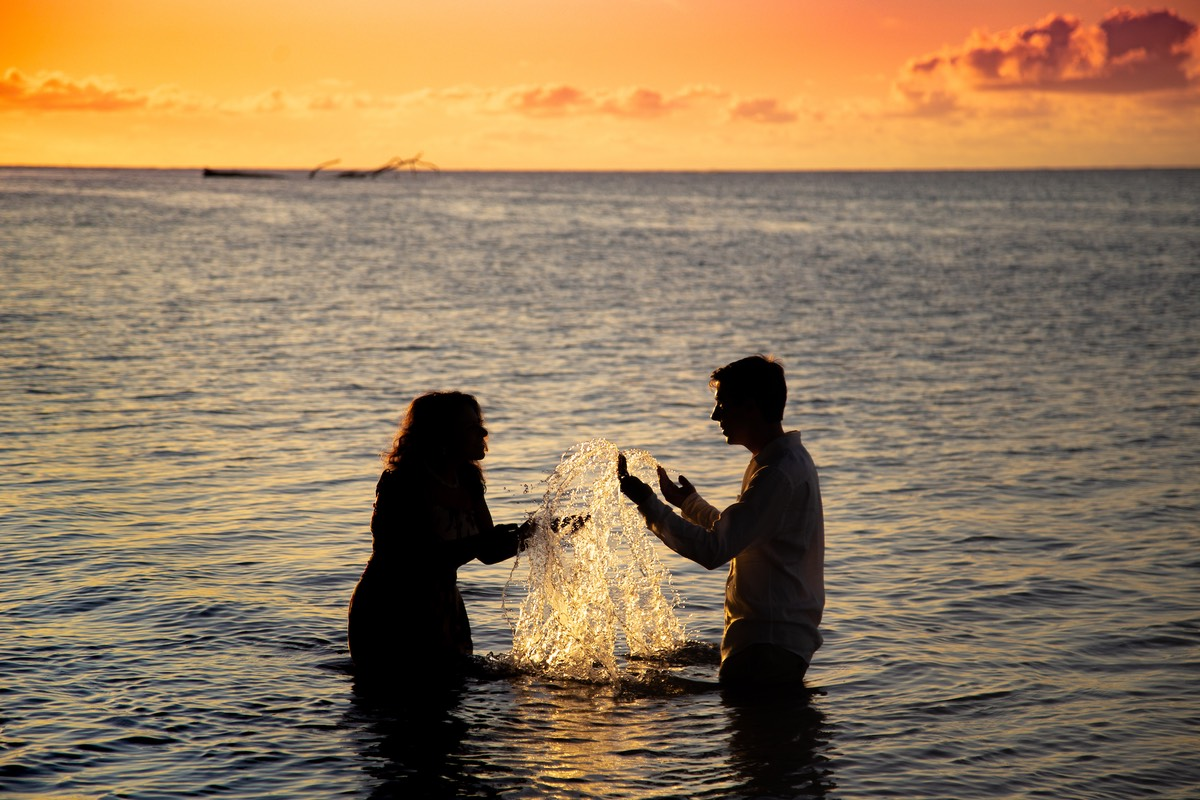 Kauai sunset bride and groom in the water.
