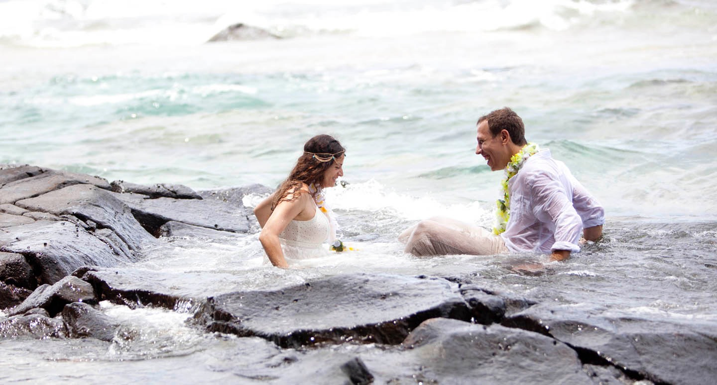 Kauai wedding videographer Difraser   gets bride into the ocean with her wedding dress