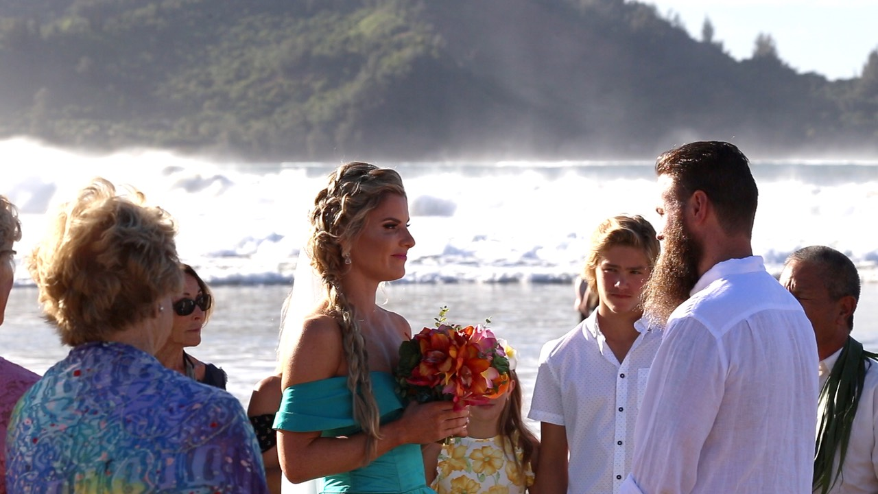 Misty ocean wedding ceremony Kauai and the bride wore blue