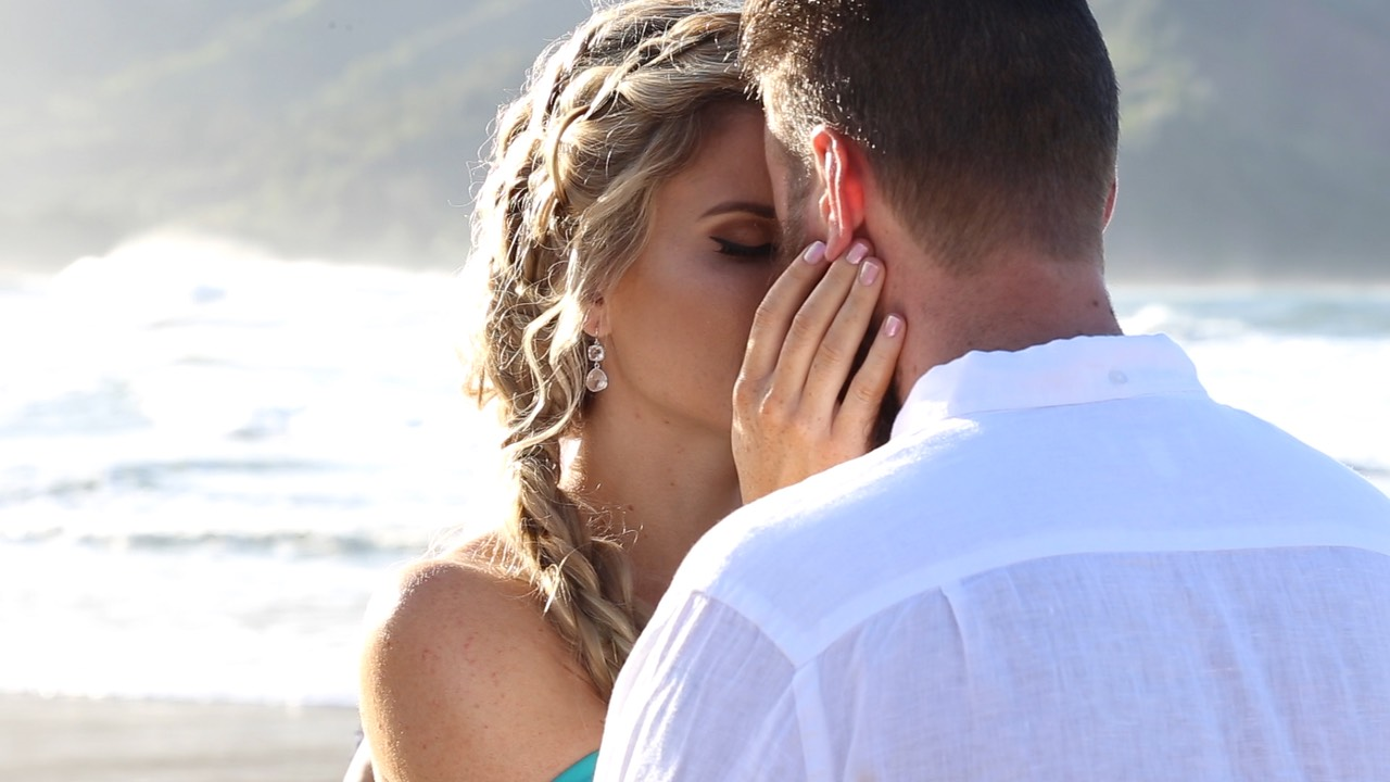 Kauai wedding bride and groom touch forehead during ceremony