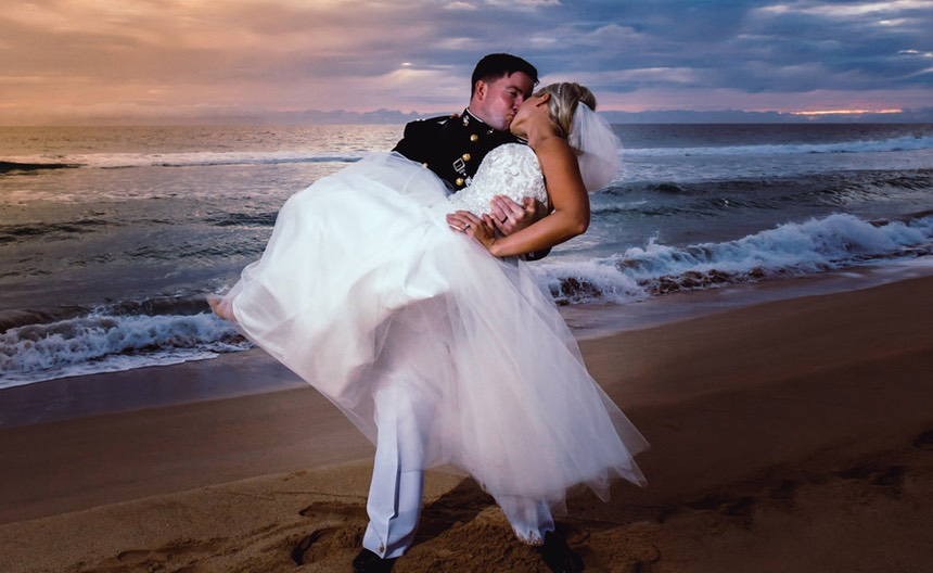 Marine carries his new bride in his arms, sunset. Kauai photographer Difraser