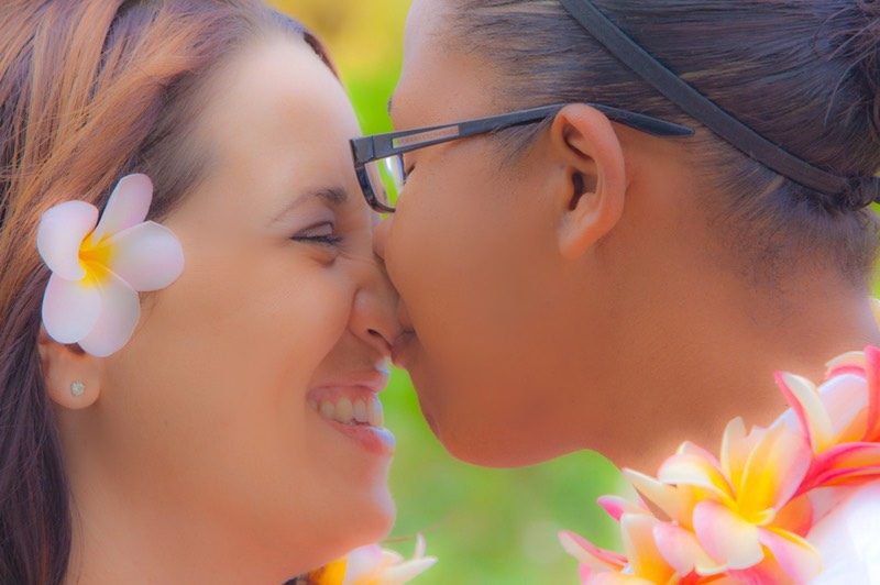 Nose to nose...happy kiss after saying I do for this same sex couple.  Kauai wedding videographer Difraser 45