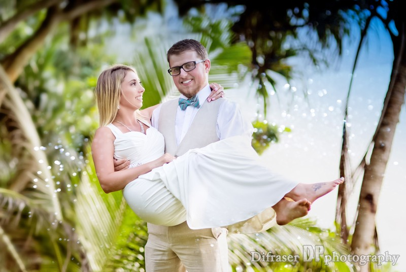 Groom carries bride off into steamy Kauai jungle.