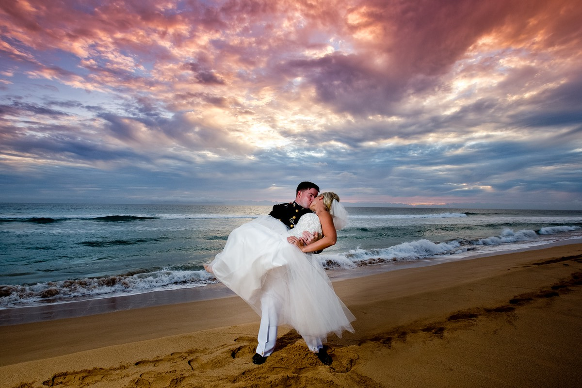 Blazing sunset on a Kauai beach for a wedding